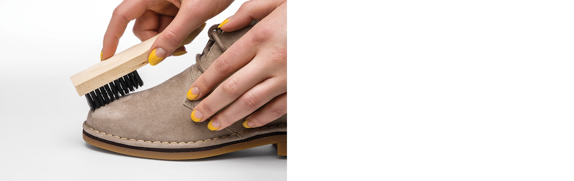 Person brushing a suede Hush Puppies shoe