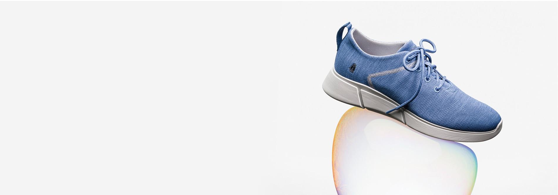 A blue Hush Puppies body shoe on a bubble
