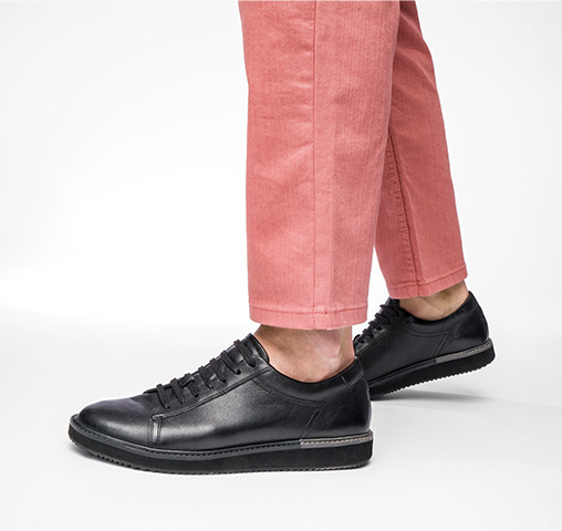 man wearing black casual Hush Puppies shoes