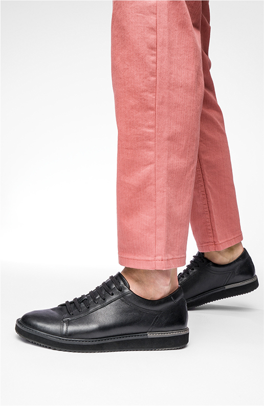 Pink pants and black sneakers.