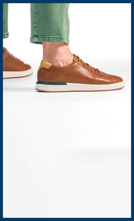 A person's feet wearing Heath Sneakers.