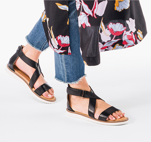 Woman wearing Hush Puppies sandals.