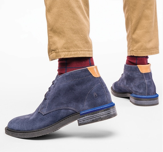 person wearing blue suede Hush Puppies boots