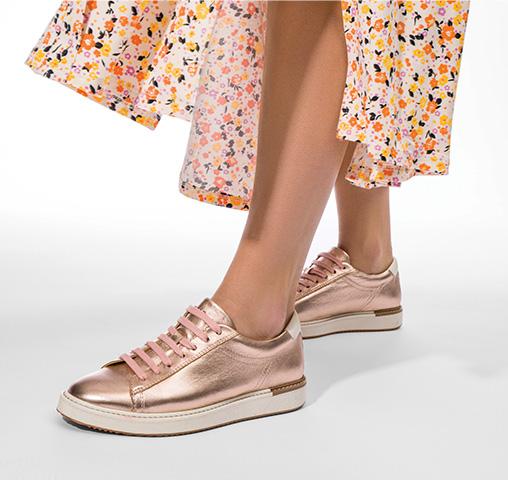 woman wearing metallic pink Hush Puppies shoes