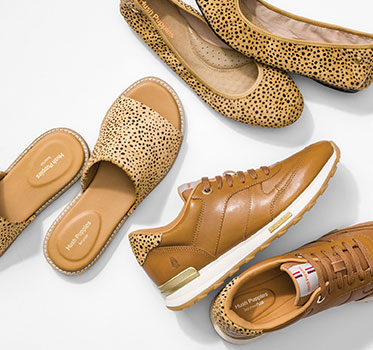 A collection of leopard print hush puppies shows.