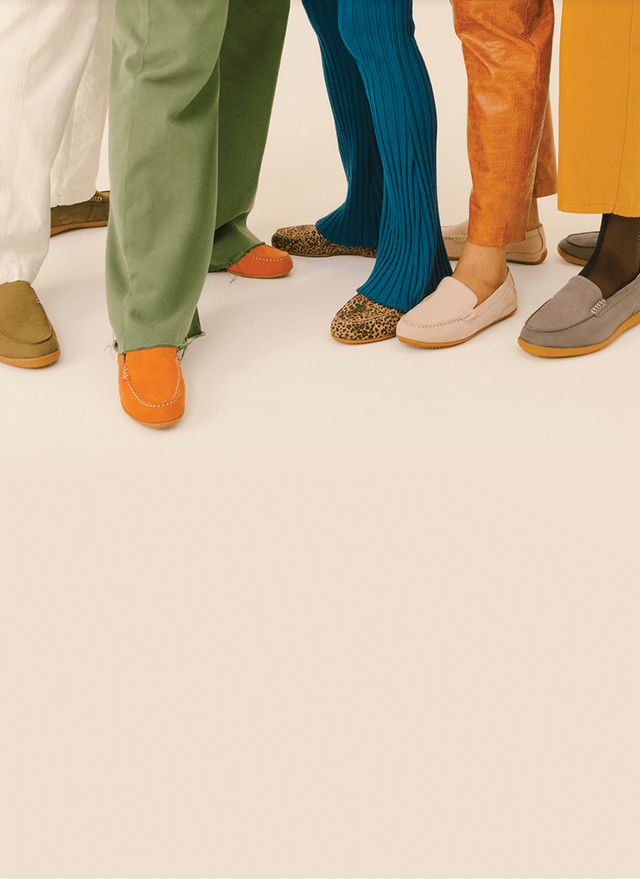 Group of people wearing Hush Puppies.