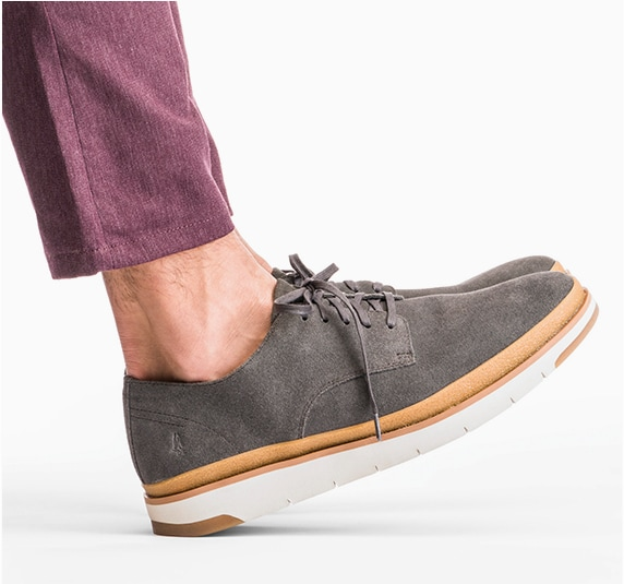 person wearhing brown Hush Puppies shoes