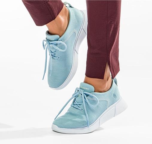woman wearing light blue Hush Puppies shoes