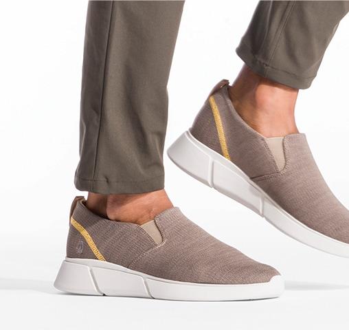 man wearing light brown Hush Puppies shoes